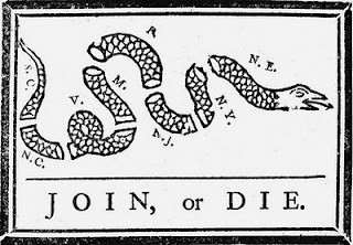 [image ALT: A schematic drawing of a snake cut into segments, labeled from the head at the right to the tail at the left: N. E., N. Y., N. J., P., M., V., N. C., S. C. It is a political cartoon by Benjamin Franklin.]